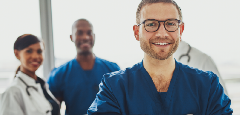 doctors wearing scrubs and smiling